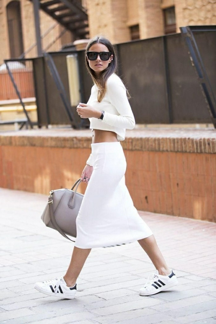 women business casual, brunette with sunglasses, wearing white long-sleeved crop top, white midi skirt, and white and black sneakers