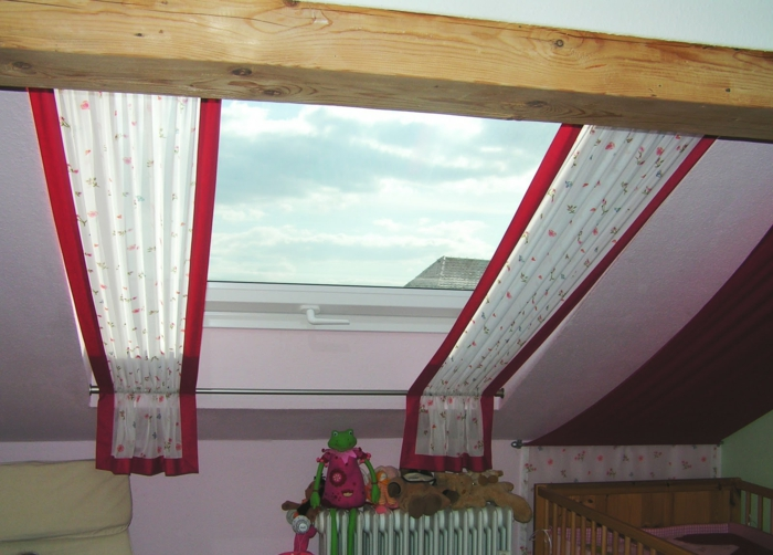 curtains ideas, nursery with pale pink walls, skylight window with red and white curtains, wooden beam and crib, with toys nearby