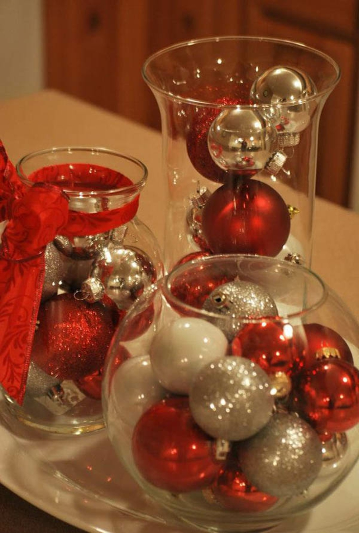 mason jar decorations, glass containers filled with red, silver and white Christmas baubles, some covered in glitter