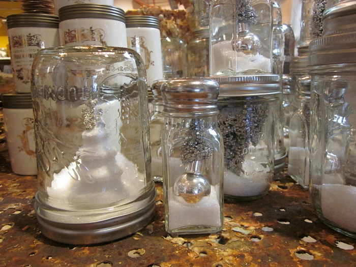 christmas mason jars, many different jars, filled with fake snow, and silver glittering christmas ornaments