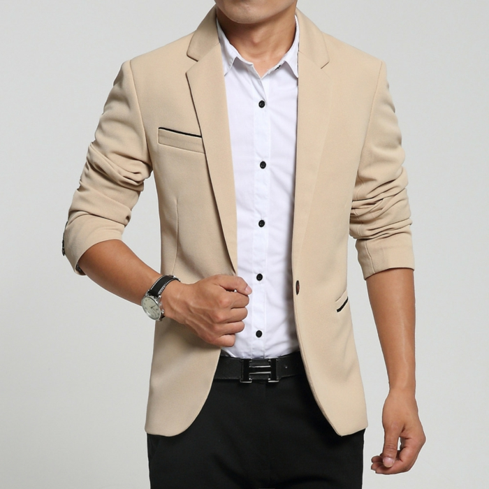 cream blazer with rolled sleeves, over white shrirt with black buttons, business casual attire, worn with black trousers and belt