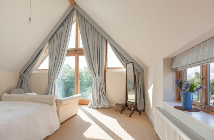curtain ideas, bedroom with gable window, decorated with long gray curtains, smaller window with grey striped fabric blinds, white sofa and bed