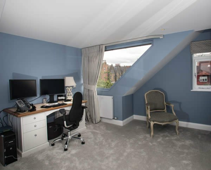 curtains ideas, attic office with blue walls, white and brown desk and black chair, two desktop computers, vintage chair and asymmetric window, with pale grey curtain
