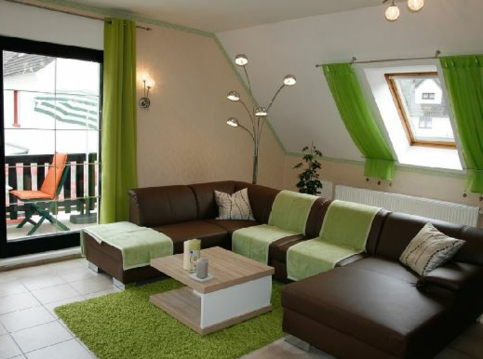 curtains for living room, brown leather sofa, small light wooden table, terrace door and small window, both decorated with vivid, light green curtains