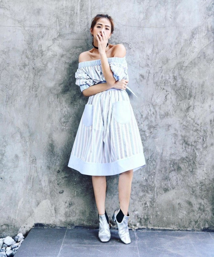 women business casual, pale blue and white, striped knee-length off-shoulder dress, worn by woman with tied back hair, wearing black chocker necklace, and silver chelsea-style ankle boots