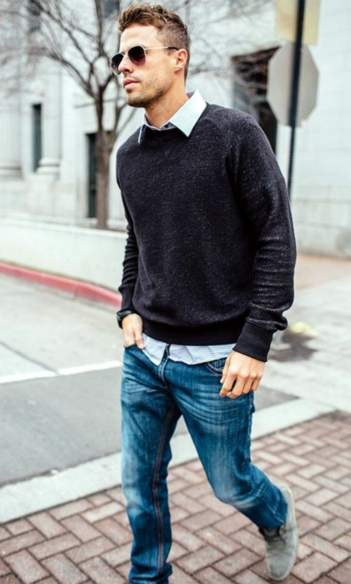 walking man with business casual jeans, combined with dark grey jumper, white shirt, and sunglasses