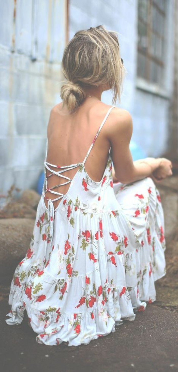 women outfits, white maxi dress, with red and green floral pattern, and lace up corset-like back detail, worn by blonde woman, with messy hair tied in knot