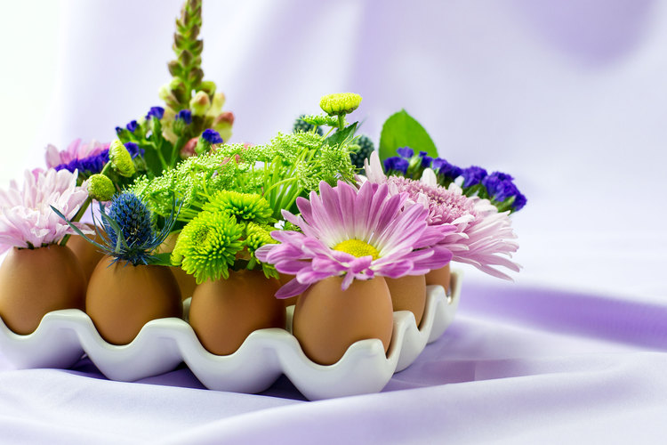 eggs placed in white holder, fun and easy crafts, decorated with pale purple, green and blue flowers