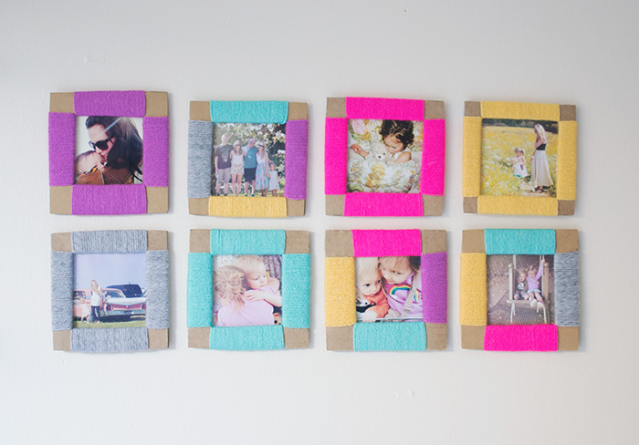 square photos in carboard frames, decorated with differently colored thread, a total of eight, mounted on white wall