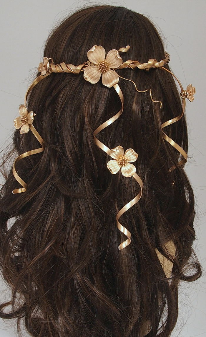 middle age hairstyles, dark brown long wavy hair, decorated with a golden diadem, featuring curly details, and several flowers