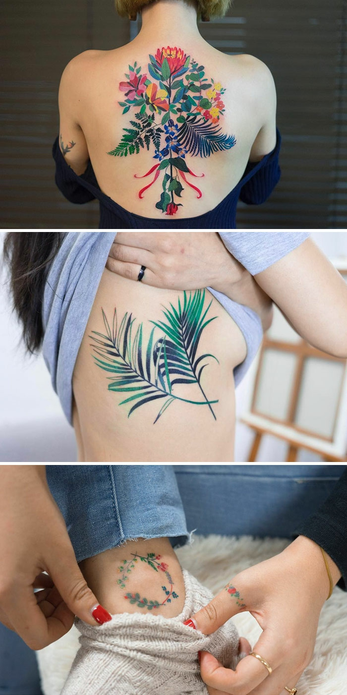 botanical tattoo, woman with a large multicolored floral back tattoo, another with a tattoo of two fern leaves, on her side, in green and blue, an ankle tattoo of a small flower wreath, in green yellow and red, tiny floral thumb tattoo