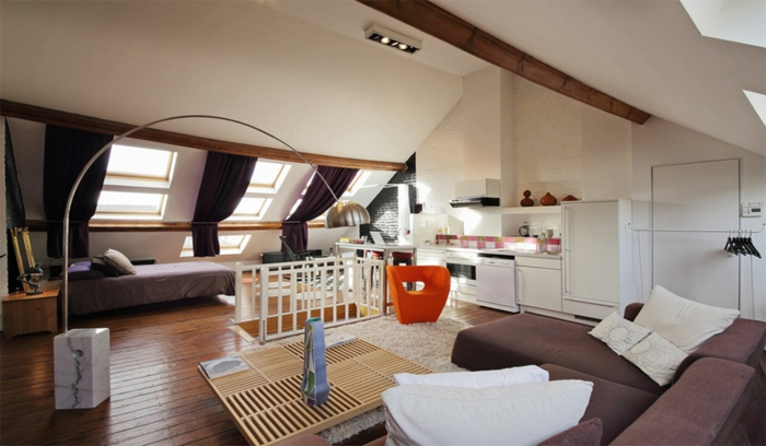 window treatment ideas, large living room with sloped ceiling, three windows with dark brown curtains, sofas and a table