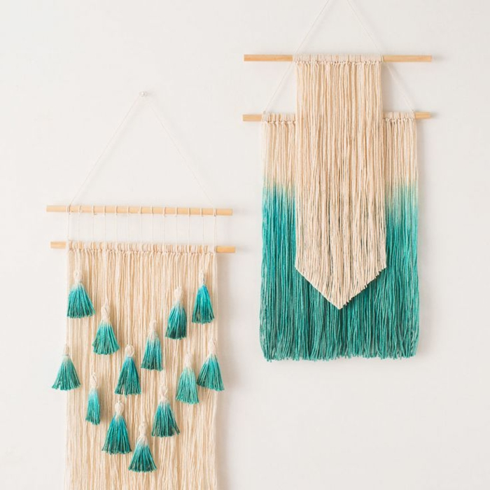 macrame wall decorations, diy craft projects, made from cream and blue, dip-dyed thread, hanging on white wall, from wooden poles