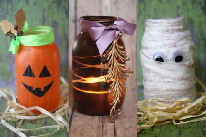 decorating mason jars, jar painted in orange, with jack-o-lantern face, purple jar with ribbon and gold ornament, mummy jar made with bandages and eye stickers