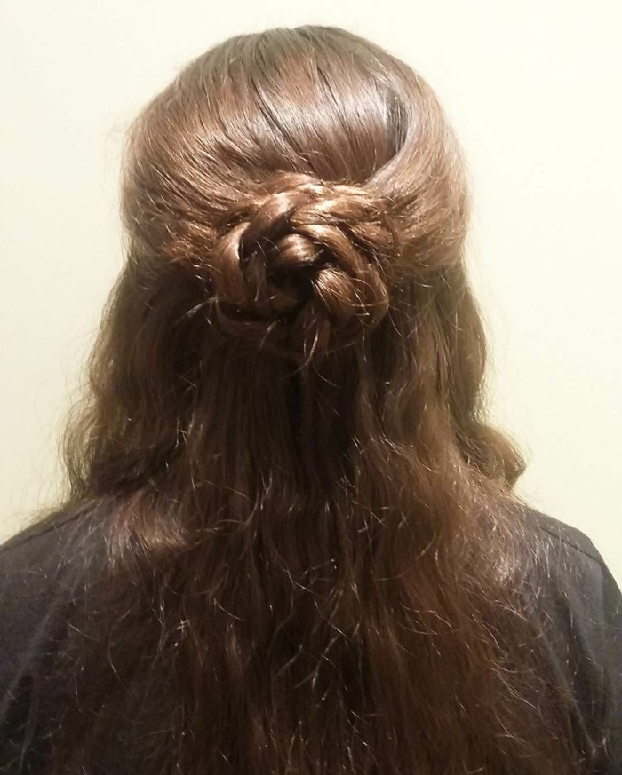 medieval braids, brown wavy hair, partially braided, to form a rose-like hair knot at the back