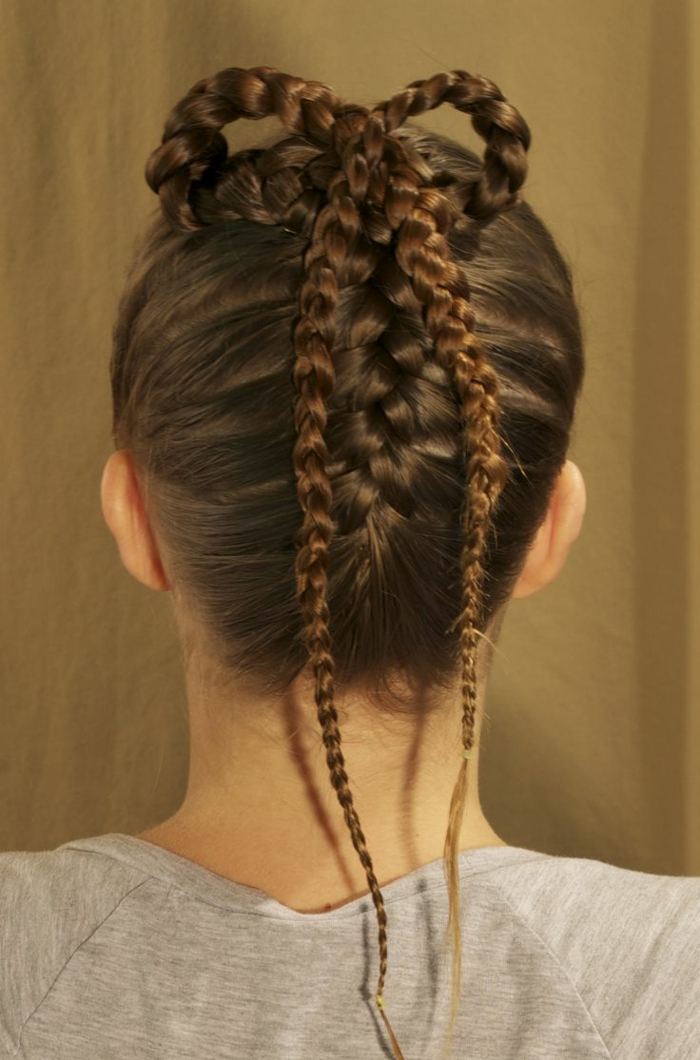 brown braided hair, inspired by medieval times, with two tight braids, forming a bow detail at the top of the head