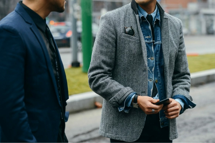 blazers in dark blue and salt and pepper grey,worn by two business casual men, one with black shirt, one with pale blue shirt, and denim jacket
