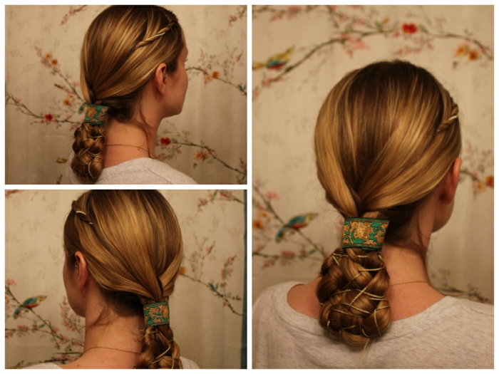 blond hair with small side twist, braided at the bottom, decorated with golden string, and a green embroidered ribbon