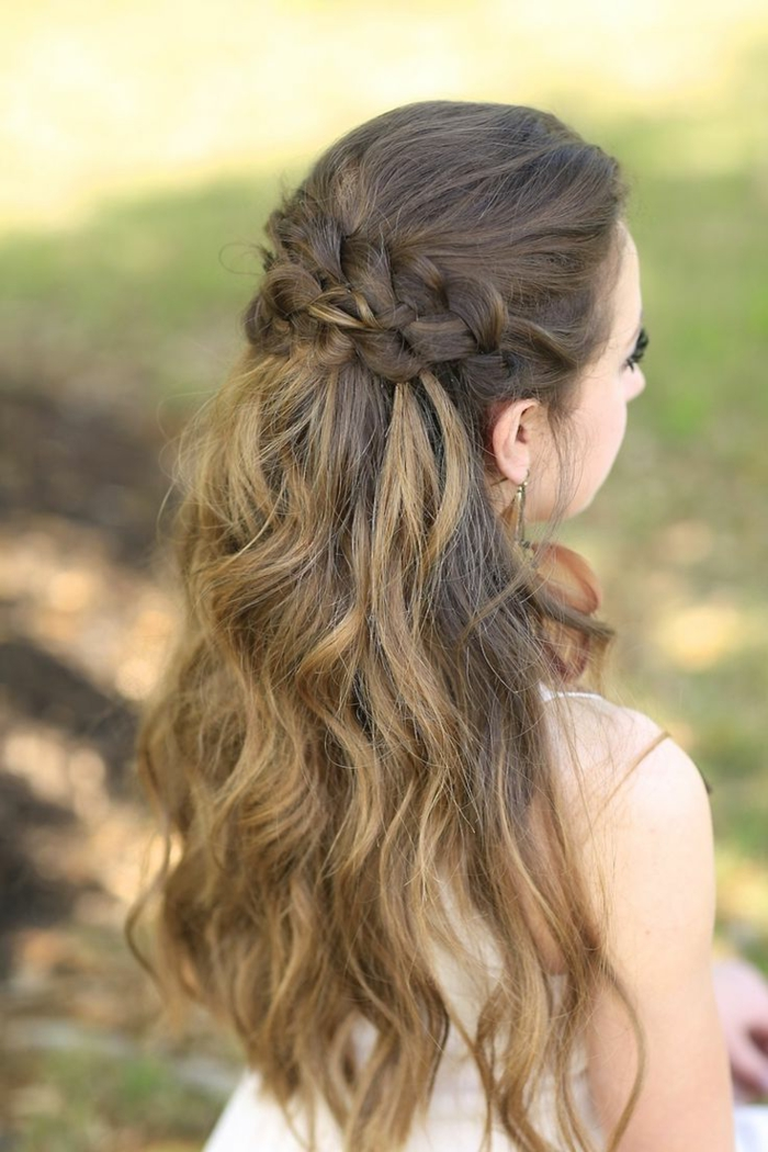 middle age hairstyles, brown and blonde wavy ombre hair, decorated with two rows of braids at the top, worn by woman in white dress