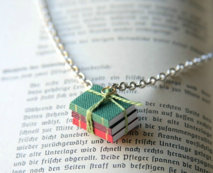 pendant made from three miniature books, tied together with green string, and attached to silver chain, easy arts and crafts, open book underneath