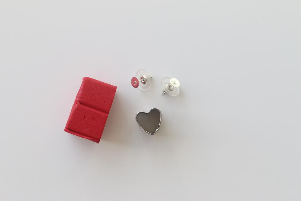 small piece of red modelling clay, art and craft ideas, two metal and clear plastic studs, tiny heart-shaped mould