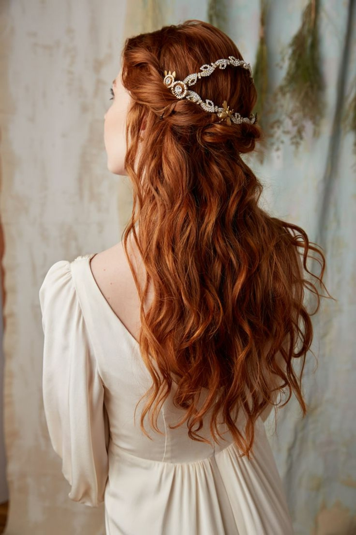 medieval times hair, wavy ginger hair, twisted like a crown at the top, decorated with a pearl and gold ornament, worn by woman in white, long-sleeved dress