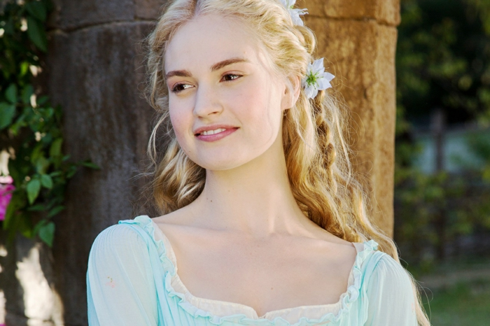 renaissance hairstyles, smiling blonde woman, in pale blue dress, with lace and frills, long wavy hair, with a braid and flowers