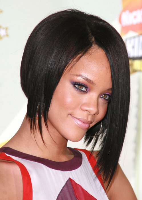 black and straight, asymmetrical shoulder length bob, worn by rihanna, in a white sleeveless top, with red and purple details