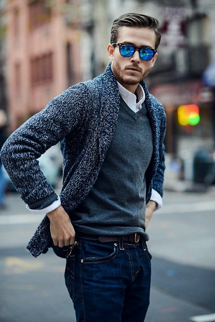 business casual jeans, worn by young man, in grey v-neck sweater, and white shirt, with pepper and salt grey cardigan, and sunglasses