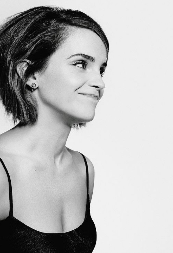 smiling emma watson, in black and white photo, with short voluminous hair, bob hairstyles, wearing black strappy top