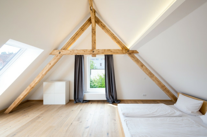 window treatment ideas, minimalist Scandinavian style attic, wooden beams and floor, dark grey curtains, two mattresses with pillows and covers