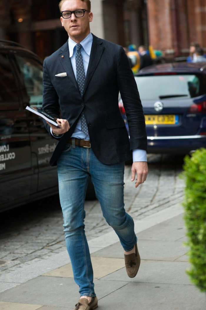 faded skinny jeans, combined with mink loafers, pale blue shirt with tie, and dark navy blazer, with white handkerchief, business casual men, worn by man with glasses