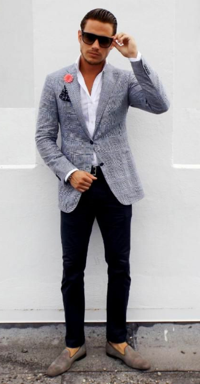 sunglasses-sporting man, with slicked back hair, wearing white shirt, black skinny pants, and a salt and chequered grey blazer, with handkerchiev and flower decoration, combined with business casual shoes,grey suede loafers