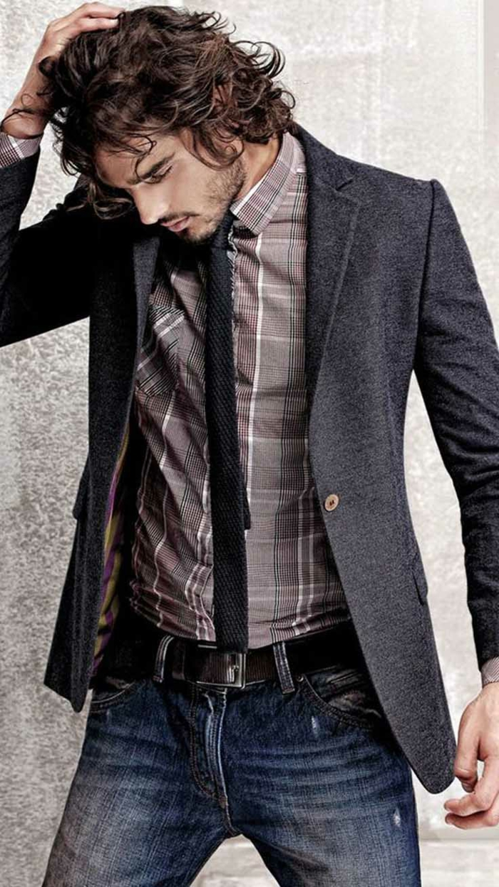 business casual men, curly-haired brunette man, dressed in grey blazer, plaid shirt with black tie, and dark denim jeans