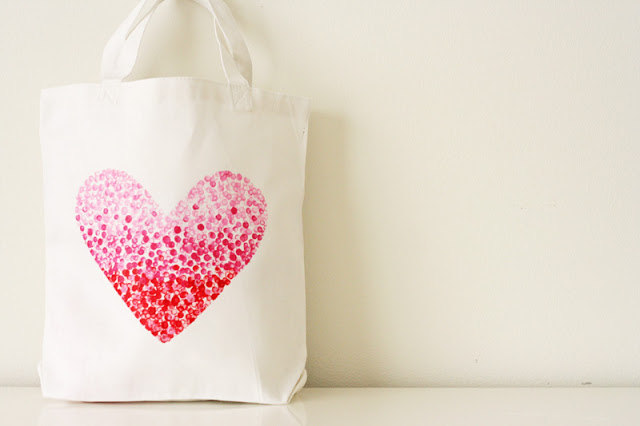 white fabric tote bag, decorated with large heart-shape print, made from little pink, and red stamped dots