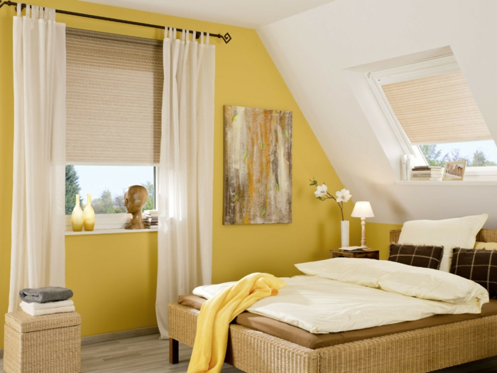 bedroom curtains, bedroom with yellow and white walls, bed in warm colors, and windows with pale cream blinds and curtains