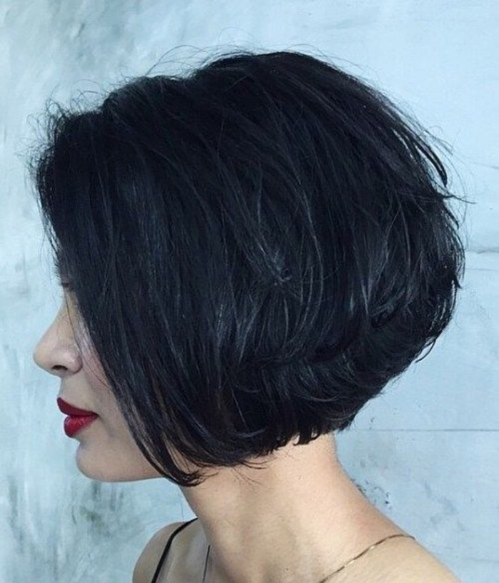 black layered hair, worn by woman with dark red lipstick, short bob hairstyles