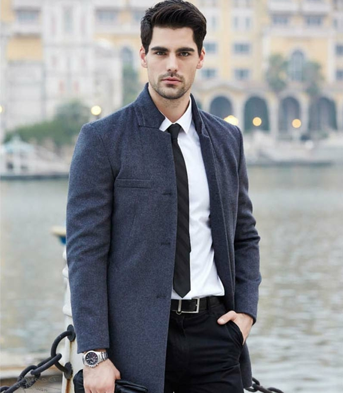 smart winter clothing, dark grey woolen coat, white shirt and black tie, black trousers with simple belt, business casual dress code, worn by man with dark hair, and short beard