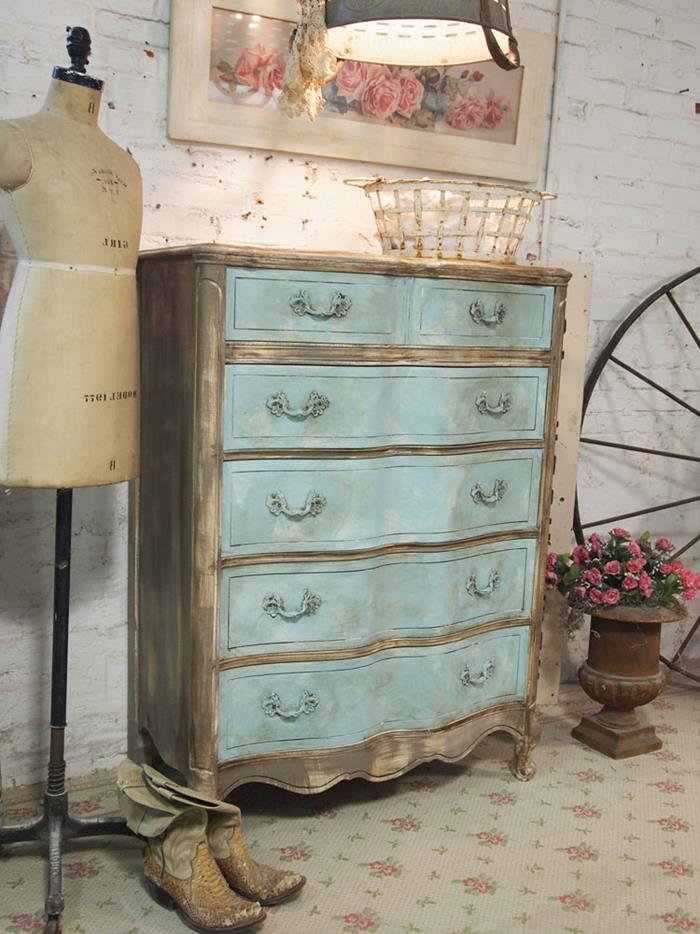 dresser in antique style, unevenly painted in grey-brown and pale turquoise, country cottage furniture, near vintage dressmaker's dummy and cowboy boots