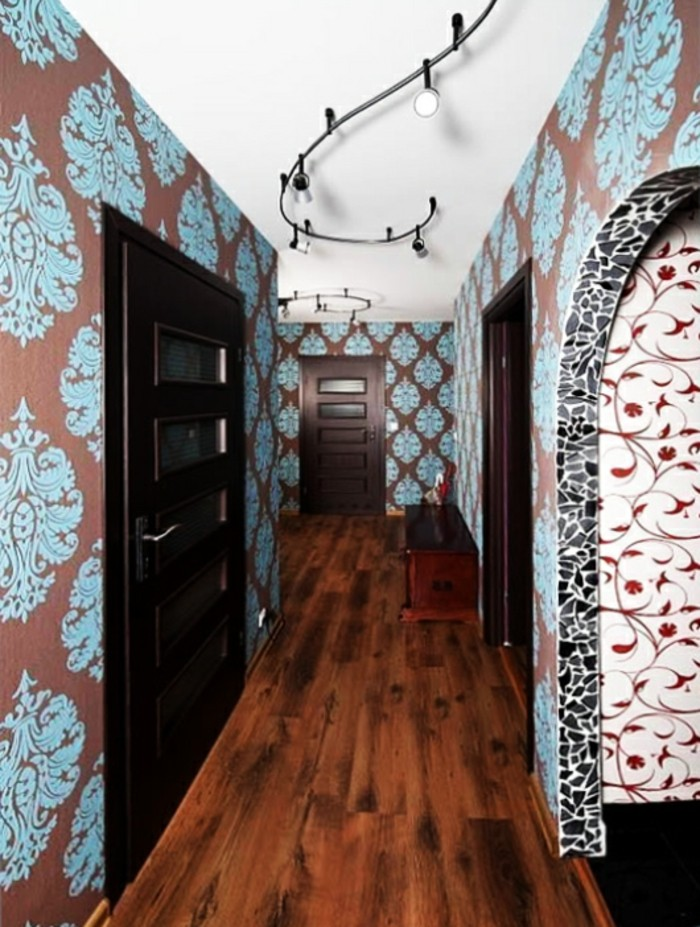 blue and brown ornamental wallpaper, inside a hall, with wooden laminate floor, and dark brown wooden doors, hallway design ideas