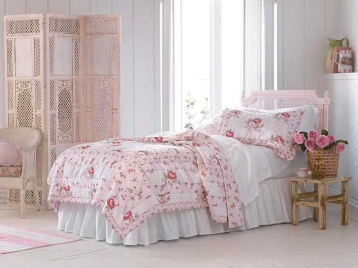 pastel pink screen and vintage armchair, in bedroom with white walls, bed with pink frame, white bedding and pink floral cover with matching pillow, shabby chic furniture
