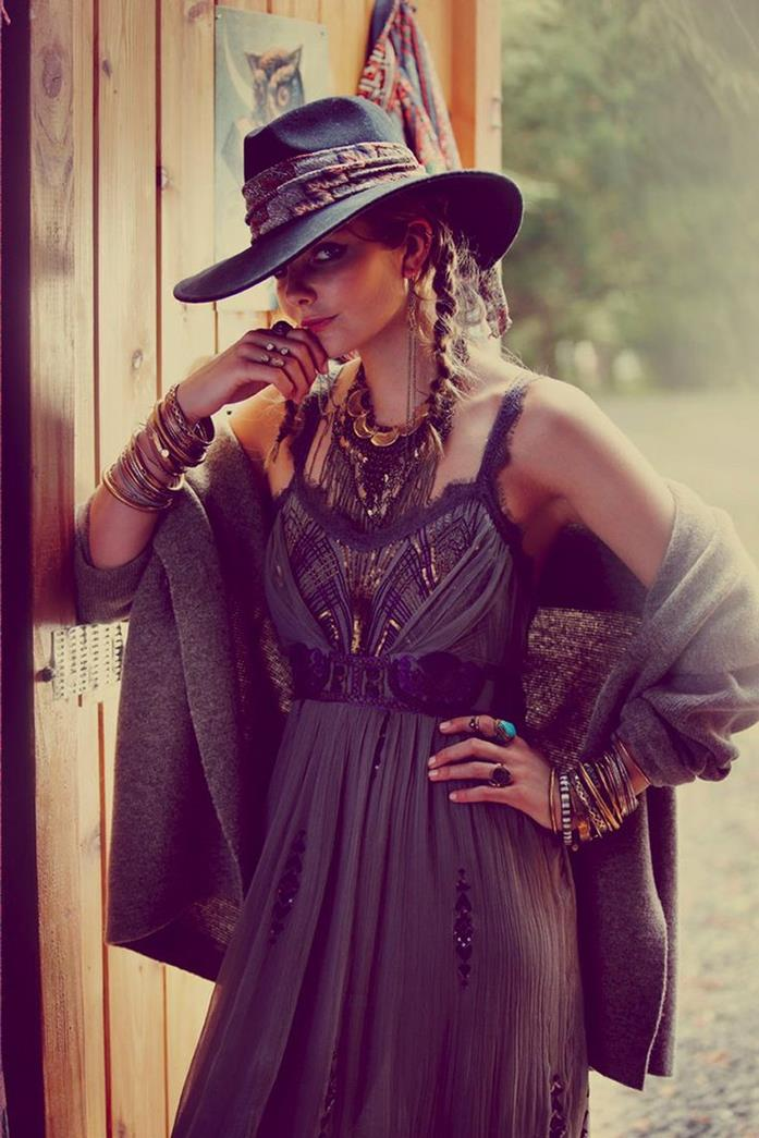 cowboy hat in black, on young, woman with two brunette braids, wearing black boho embroidered maxi dress, and a dark grey shawl, boho clothing