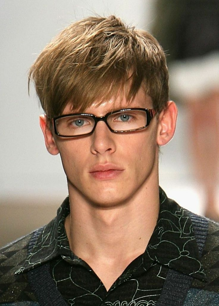 glasses and a patterned shirt, with silver threads, on young man with glasses, and blonde layered hair, with choppy bangs falling on his forehead