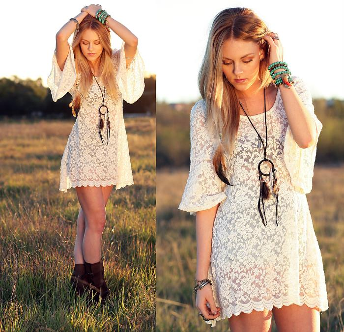 mini lace dress in white, worn by blonde woman, with long hair, boho style dreamcatcher necklace, brown ankle boots, and beaded turquoise bracelets