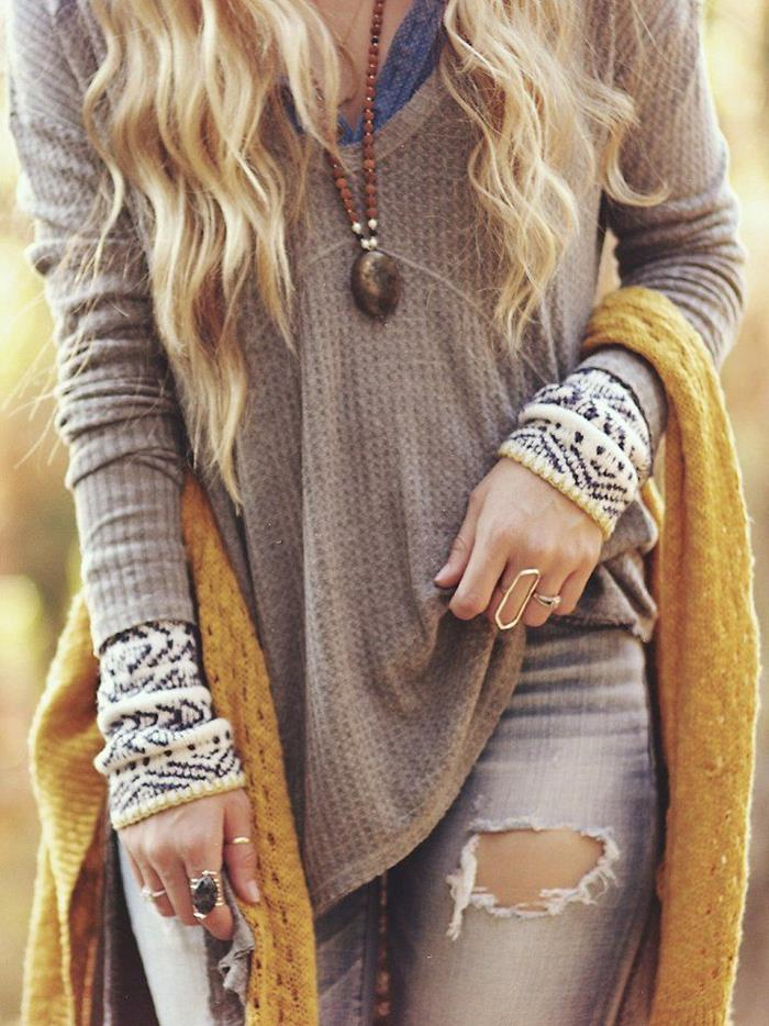 mink-colored jumper, over blue top, and white patterned jumper, layered boho chic look, worn with distressed torn pale grey jeans, and mustard yellow knitted shawl