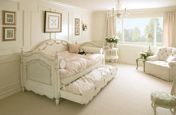 pale beige carpet, in a child's bedroom, white antique french sofa bed, with decorative elements, vintage armchair and small tables, shabby chic furniture, chandelier and old-looking chair