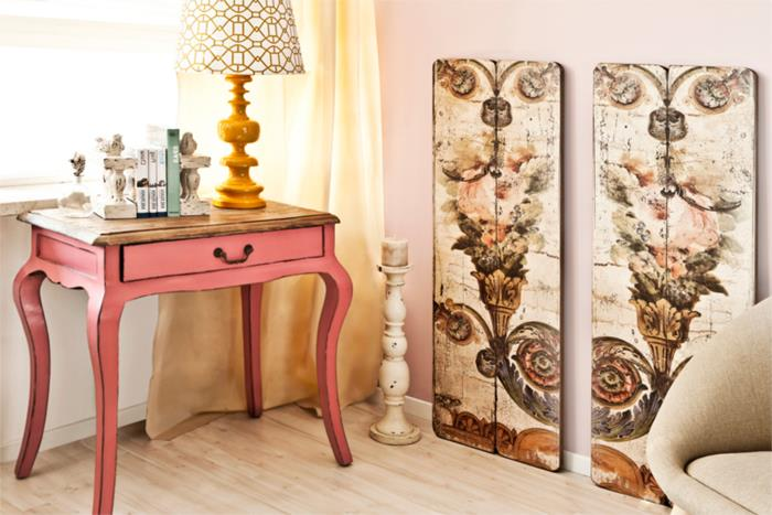 nightstand table in coral pink, in antique style with small drawer, country cottage furniture, decorative painted wooden boards, lamp and other items