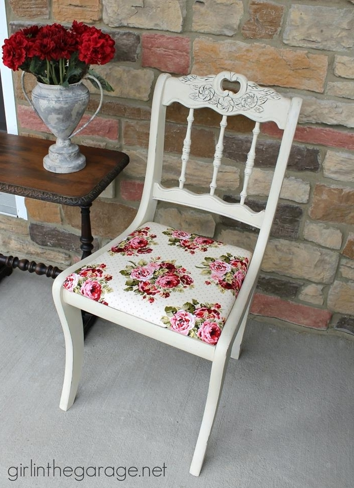 rose patterned fabric in pink, green and white, on antique wooden chair, painted in white