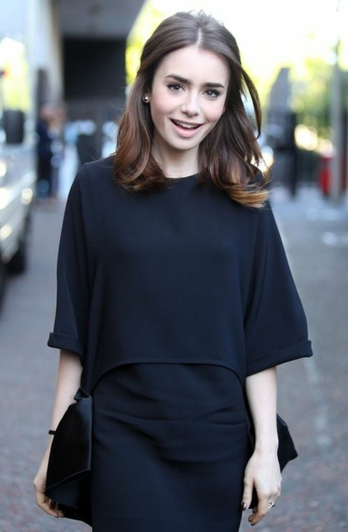 lily collins wearing a black free-cut dress, with 3/4 sleeves, with pink blush and nude lipstick, partially tied back brunette hair, with parting in the middle, dark haired actresses