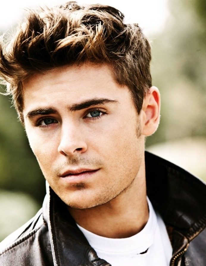 messy spikes on light brown hair, shorter at the sides, worn by young man, in dark brown leather jacket, and white t-shirt, boys short haircuts, zac efron